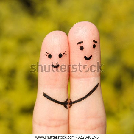 Finger art of a Happy couple. Happy couple holding hands on the background of yellow leaves - stock photo