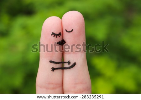 Finger art of a Happy couple. The happy couple kissing and hugging. - stock photo