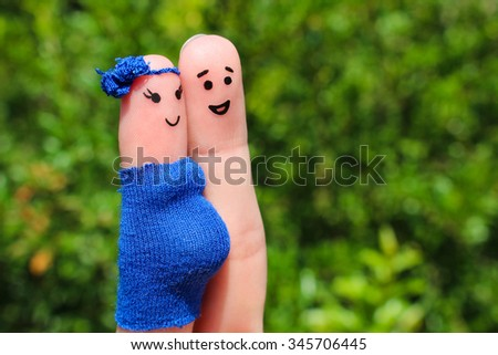 Finger art of a Happy couple. woman is pregnant.  - stock photo