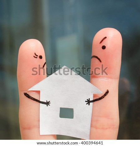 Finger art of family during quarrel.  Concept of man and woman can not divide house after divorce. - stock photo