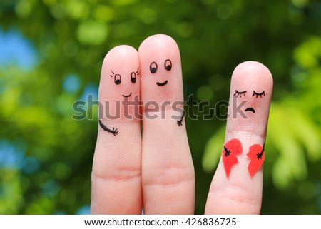 Finger art of Happy couple hugging. Other girl is holding a broken heart. - stock photo