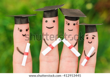 Finger art of students. Graduates holding their diploma after graduation. Toned image  - stock photo