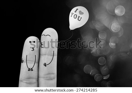 Finger cartoon Hug and kiss and holding balloon on green bokeh background , Black and white style