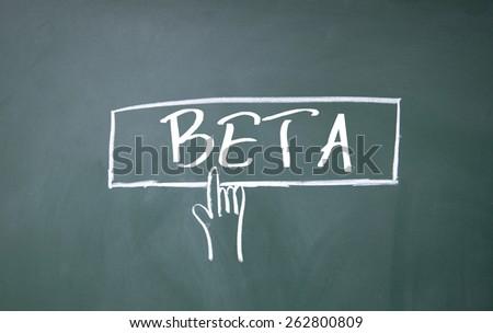 finger click beta symbol on blackboard - stock photo