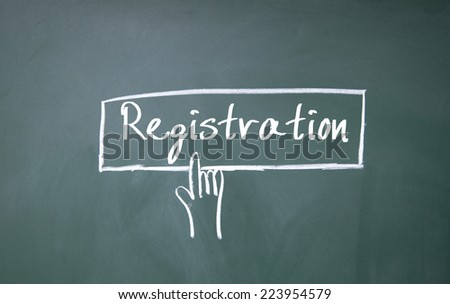 finger click registration symbol on blackboard - stock photo