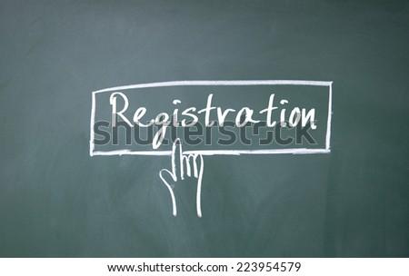 finger click registration symbol on blackboard - stock photo