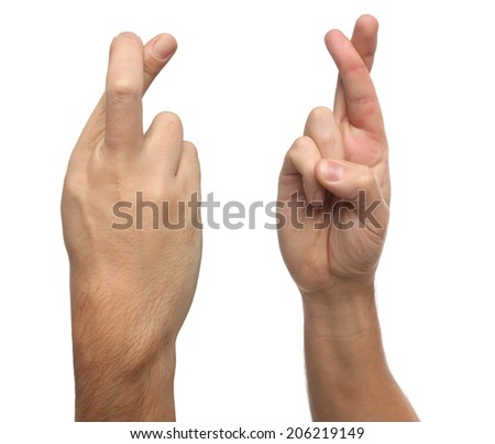 Finger crossed male hand sign. Isolated on white background - stock photo