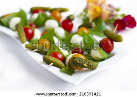 Finger food: set of cherry tomatoes, mozzarella and basil - stock photo