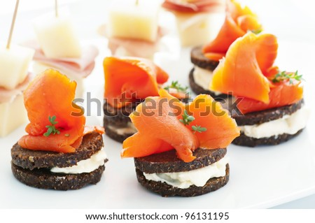 Finger food with salmon and ham - stock photo