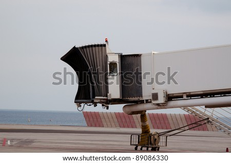 Finger Gate In Airport At The Coast - stock photo
