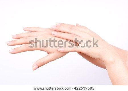 finger hand symbols isolated concept  closeup shot of beautiful women hands applying hand cream on the white background  - stock photo