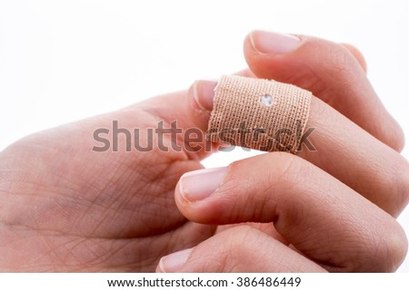 finger in white bandage on a white background