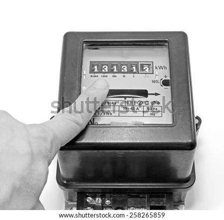 finger indicating the number on the meter of electricity - stock photo