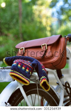 Finger less mittens on the bicycle - stock photo