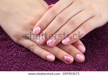 Finger nail treatment,hands with painted fingernails - stock photo