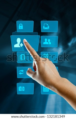 finger of a woman, selects and opens a folder - stock photo