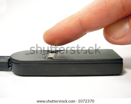 Finger on biomtric scanner - stock photo