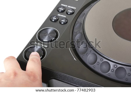 Finger on button of dj cd player, closeup