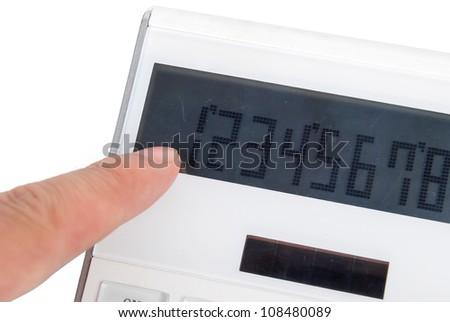 Finger on calculator - stock photo