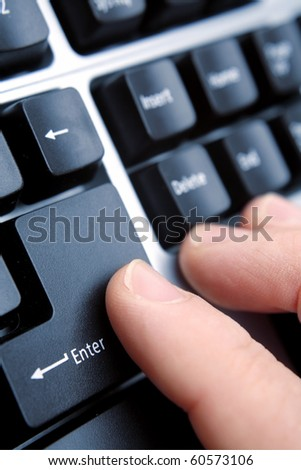 Finger on computer keyboard enter key