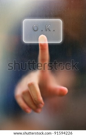 finger on glass as blur background - stock photo