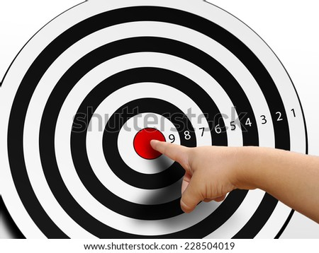 Finger on the target, point to the center - stock photo