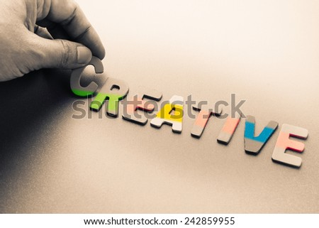 Finger pick a wood letters of Creative word - stock photo
