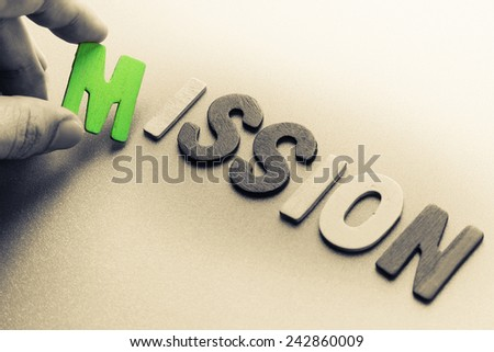 Finger pick a wood letters of Mission word - stock photo