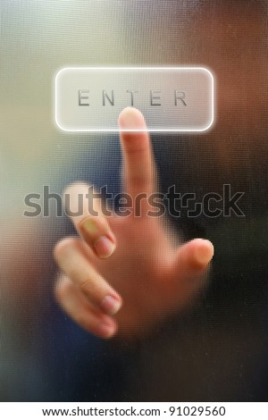 finger point as blur motion on enter key as background - stock photo