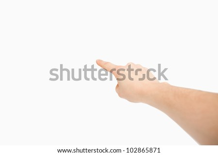 Finger pointing a blank space against a white background - stock photo