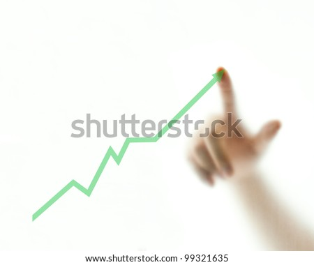 Finger pointing at the rising green graph - stock photo