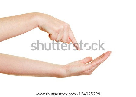 Finger pointing demanding on empty palm of hand