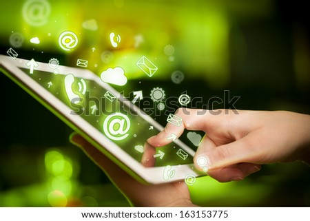Finger pointing on tablet pc, social media concept - stock photo