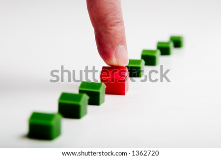 finger pointing red house, real estate concept