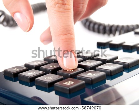 finger presses figure on a phone - stock photo