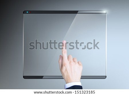 finger presses on the touch screen - stock photo