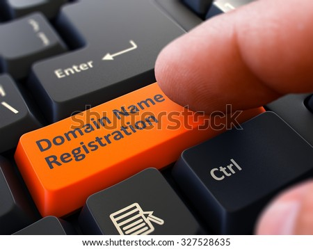 Finger Presses Orange Button  Domain Name Registration on Black Keyboard Background. Closeup View. Selective Focus. - stock photo