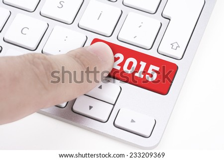 finger pressing keyboard key written 2015 newyear - stock photo
