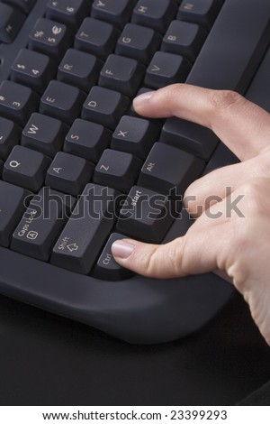 Finger pressing the keyboard as for the copy command. - stock photo
