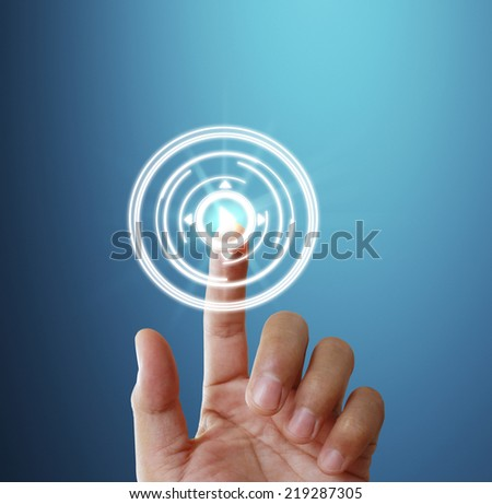 Finger pressing the touch screen display  - stock photo