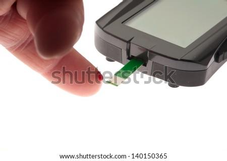 finger prick blood test - stock photo