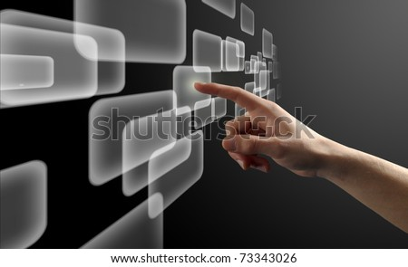 Finger pushing button on a touch screen interface - stock photo