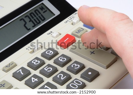"Finger pushing ""plus"" key on a business calculator"