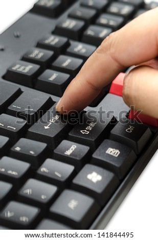 Finger pushing the button ENTER on the keyboard - stock photo