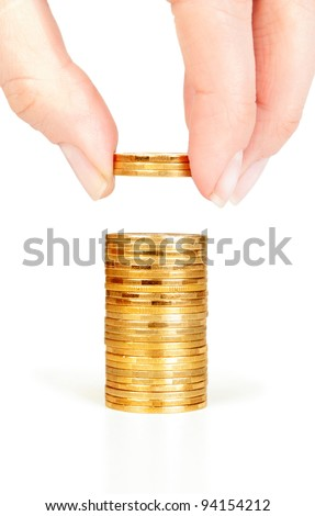 Finger put coins on coin-stack - stock photo