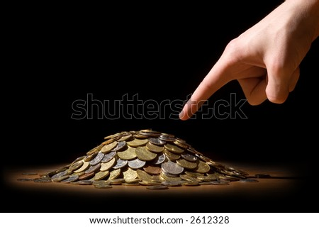 Finger, showing on a pile of money - stock photo