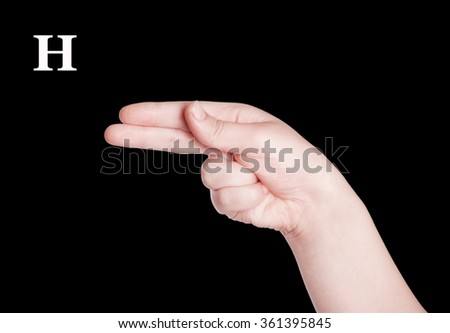 Finger Spelling the Alphabet in American Sign Language (ASL). The Letter H - stock photo