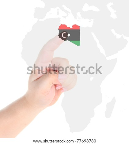 Finger touch on a future innovative transparent screen display Libya map flag - stock photo