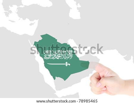 Finger touch on a future innovative transparent screen display Saudi Arabia map and flag - stock photo