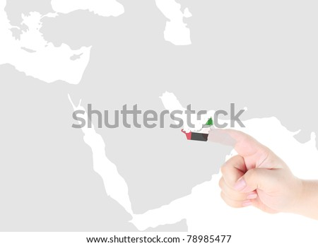 Finger touch on a future innovative transparent screen display United Arab Emirates , U.A.E map and flag - stock photo